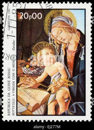 GUINEA BISSAU - CIRCA 1985: Stamp printed in Guinea-Bissau shows Virgin and Child by Botticelli, circa 1985 - Stock Photo