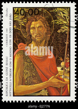 GUINEA BISSAU - CIRCA 1985: Stamp printed in Guinea-Bissau shows Virgin and Child with St. John - detail by Botticelli, - Stock Photo
