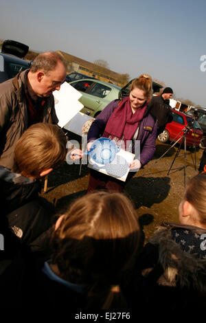 Madley, Herefordshire UK. 20th March, 2015.  School teacher demonstrates how to view the solar eclipse using a kitchen - Stock Photo