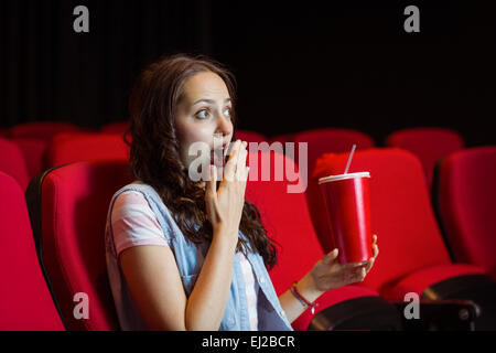 Young woman watching a film - Stock Photo