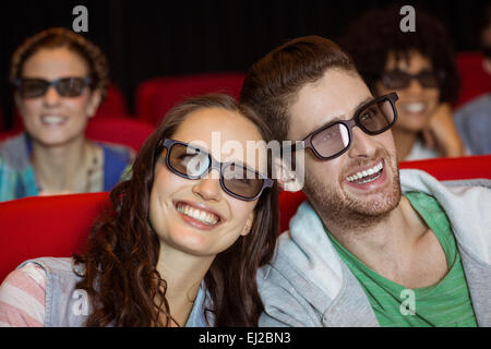 Young couple watching a 3d film - Stock Photo