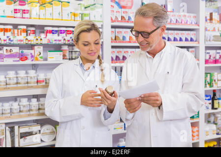 Team of pharmacist talking together about medication Stock Photo ...