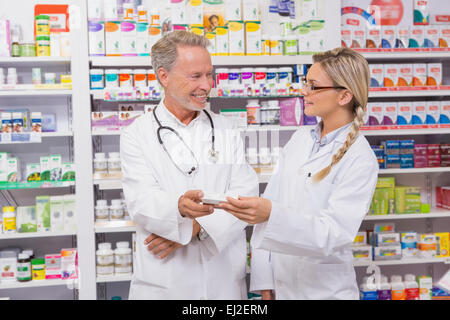 Pharmacist speaking with his trainee about medicine Stock Photo ...