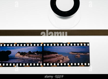 Slides strip and Loupe on Lightbox - Stock Photo