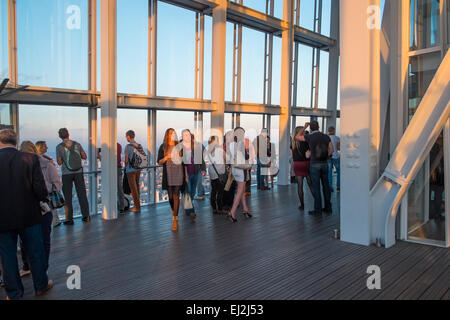 LONDON, UK - OCTOBER 3, 2014: Visitors on the viewing platform in The Shard, the tallest building in London at sunset - Stock Photo
