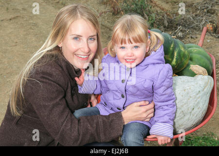 An attractive Mother and Daughter Portrait in Pumpkin - Stock Photo