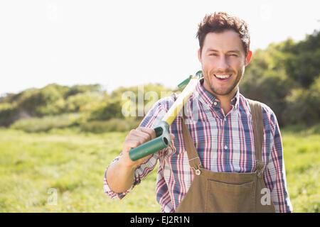 Happy farmer smiling at camera - Stock Photo