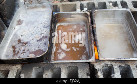 Detroit, Michigan - Sap from sugar maple trees is boiled over a wood fire to make maple syrup. - Stock Photo