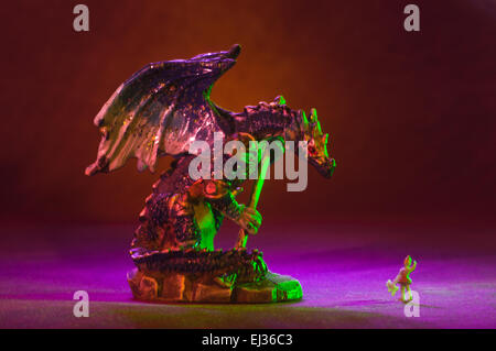 Small toy gothic dragons with lighting effects in studio setting - Stock Photo