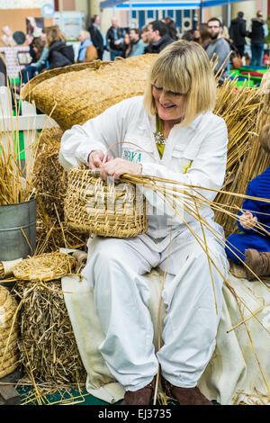 London, UK. 20th March 2014 Alexandra Palace Edible Garden Show Basket weaving demostartion  Credit:  Paul Chambers/Alamy - Stock Photo
