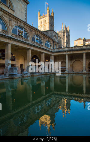 Great Bath at the Roman Baths with the Bath Cathedral beyond, Bath, Somerset, England, UK - Stock Photo