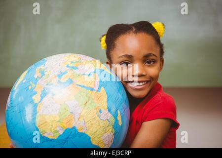 Cute little girl holding globe - Stock Photo