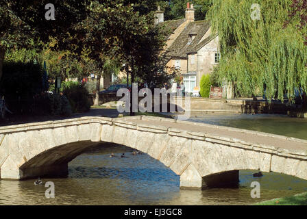 Old Stone bridge over River Windrush  in Bourton on the water Cotswolds Gloucestershire England UK Europe - Stock Photo