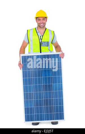 Smiling handyman with solar panel - Stock Photo