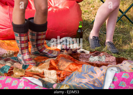 Hipsters having fun in their campsite - Stock Photo