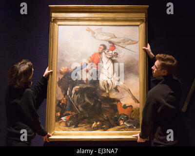 London, UK. 20 March 2015. Pictured: Two Bonhams employees hang the oil painting 'The Fight for the Standard' after - Stock Photo