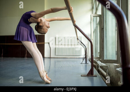 female ballet dancer doing stretching exercising at a