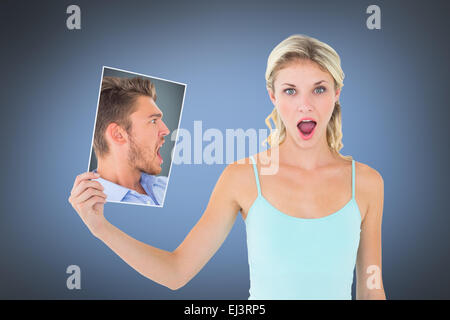 Composite image of angry man looking at page - Stock Photo