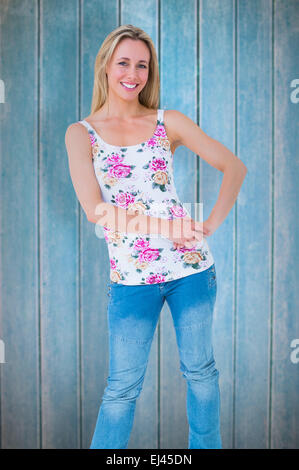 Composite image of smiling blonde posing with hand on hip