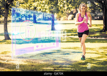 Composite image of fit blonde jogging in the park - Stock Photo