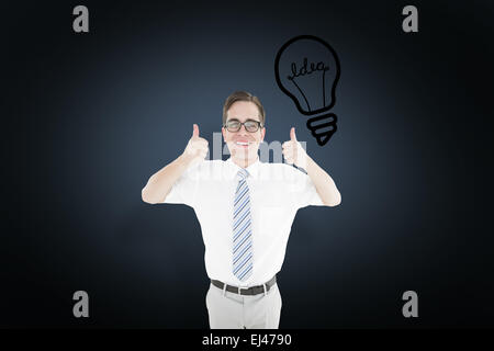 Composite image of geeky happy businessman showing thumbs up - Stock Photo
