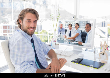 Composite image of business people brainstorming - Stock Photo