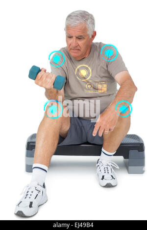Composite image of full length of a senior man exercising with dumbbell - Stock Photo