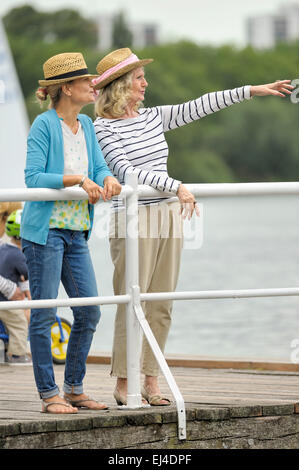 Mother and daughter standing on a landing stage - Stock Photo