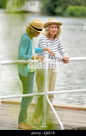 Mother and daughter having a discussion - Stock Photo
