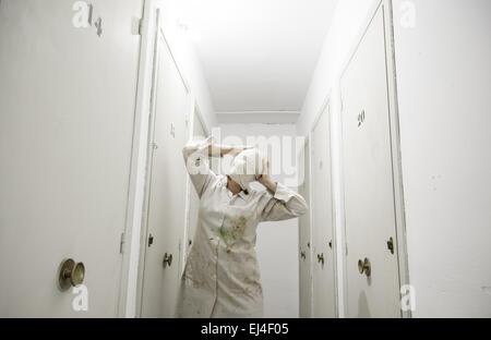 Woman with bandaged storage white coat, fear Stock Photo, Royalty ...