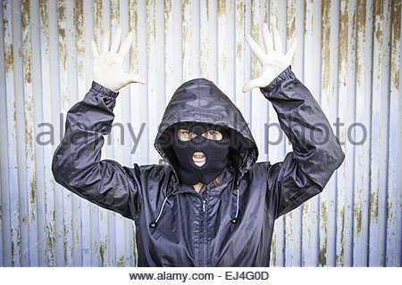 Woman with ski masks and violent hooded mask - Stock Photo