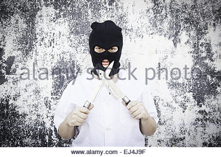 Violent woman with bloody mask, halloween - Stock Photo