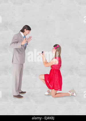 Composite image of pretty hipster on bended knee doing a marriage proposal to her boyfriend - Stock Photo