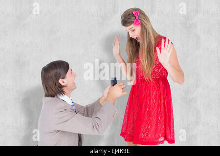 Composite image of hipster on bended knee doing a marriage proposal to his girlfriend - Stock Photo