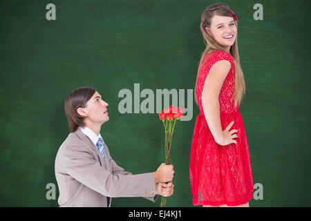 Composite image of hipster on bended knees behind his girlfriend - Stock Photo
