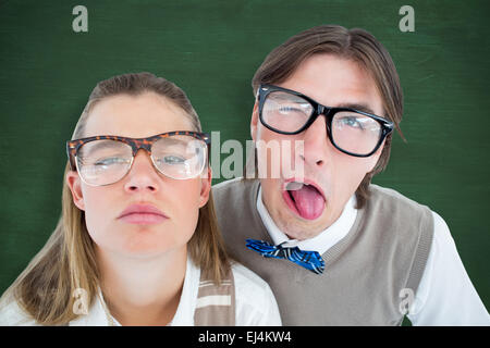 Composite image of funny geeky hipsters grimacing - Stock Photo
