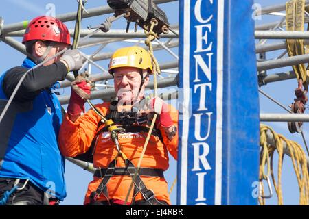 Salford, Greater Manchester UK  21st  March  2015 93 year-old Frank Tolley zip wires across the Manchester Ship - Stock Photo