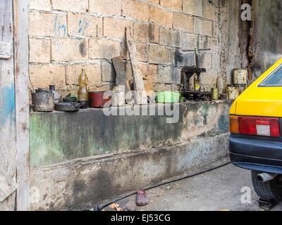Close-up of part of an automotive repair shop in Santiago de Cuba. - Stock Photo