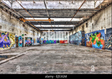 Graffiti in a brownfield site factory - Stock Photo