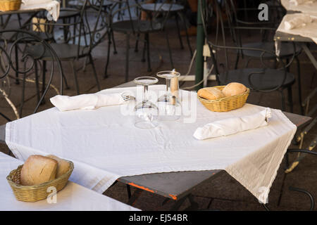 Laid table at a street restaurant, Avignon, Vaucluse, Provence-Alpes-Cote d'Azur, Southern France, Europe - Stock Photo