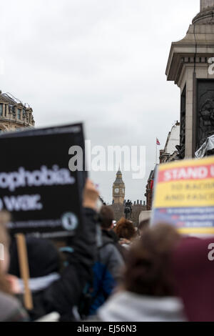 London, 21st March 2015 Anti-racism protesters gather in Trafalgar Square for a rally with Big Ben in the background - Stock Photo