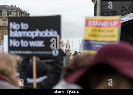 London, 21st March 2015 Anti-racism protesters gather in Trafalgar Square with Big Ben in the background - Stock Photo