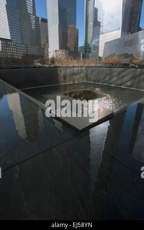 One World Trade Center (1WTC), Freedom Tower reflections and Footprint of WTC, National September 11 Memorial, New - Stock Photo