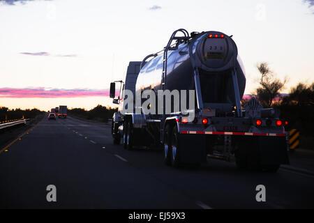 18-wheeler semi-truck tanker drives west on Interstate 10, near Palm Springs, California, USA - Stock Photo