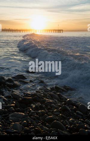 Ocean waves at sunrise with Ventura Pier, Ventura, California, USA - Stock Photo