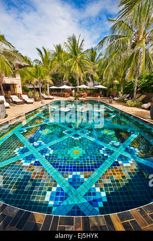 Colorful tiled water pool at Mia Resort Mui Ne. Mui Ne, Binh Thuan Province, Vietnam. - Stock Photo
