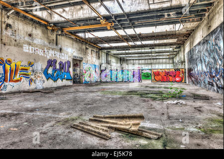 Dilapidated warehouse in an abandoned factory - Stock Photo