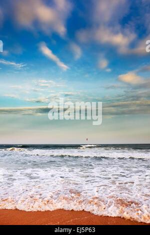 Ocean waves pounding on Mui Ne Beach. Mui Ne, Binh Thuan Province, Vietnam. - Stock Photo