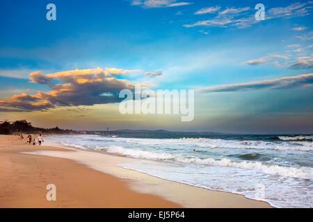 View of Mui Ne sandy beach at sunset. Mui Ne, Binh Thuan Province, Vietnam. - Stock Photo