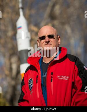 International Space Station Expedition 43 Commander NASA Astronaut Scott Kelly stands near a model of the Soyuz - Stock Photo